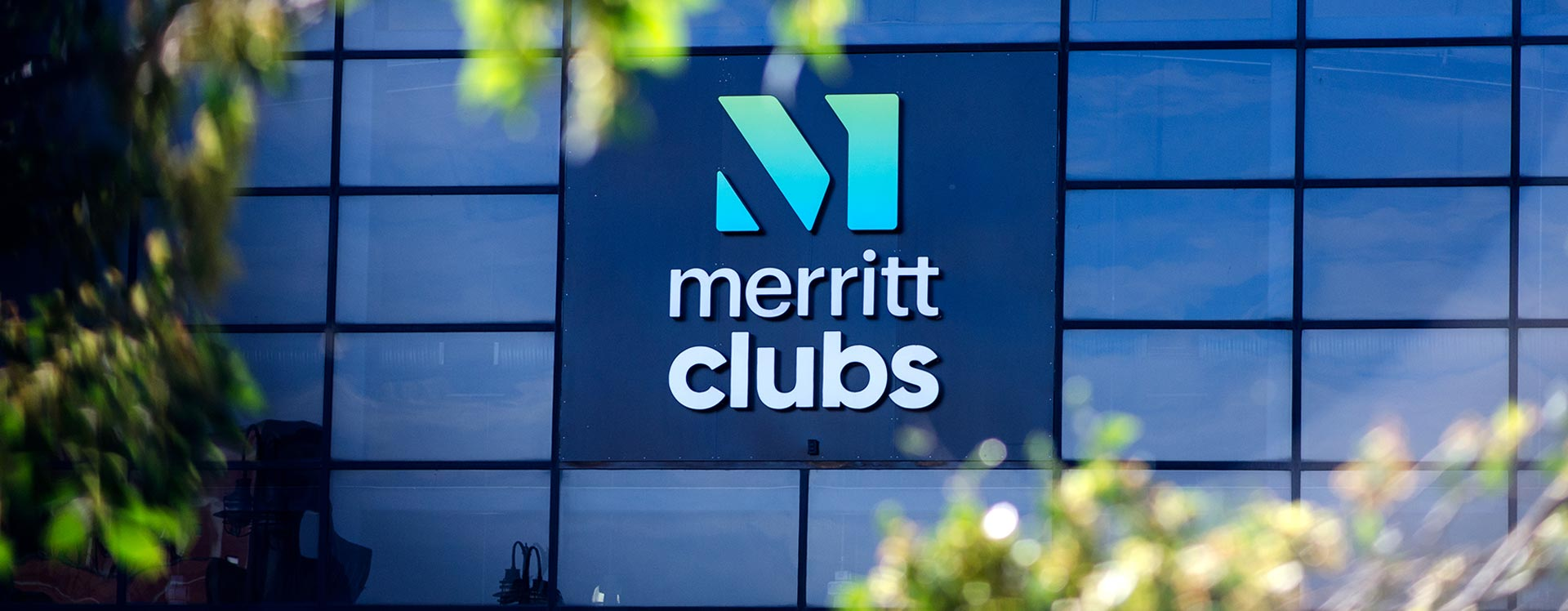 Merritt Clubs Logo on a building - Baltimore based gym