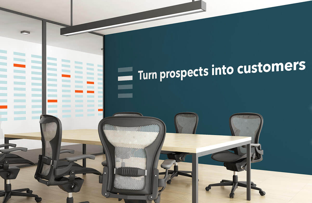 Grafik incorporated RainKing's brand identity and rebranding efforts down to the wall of their office, as displayed in this image of one of their conference rooms with the mantra proudly displayed on the wall.