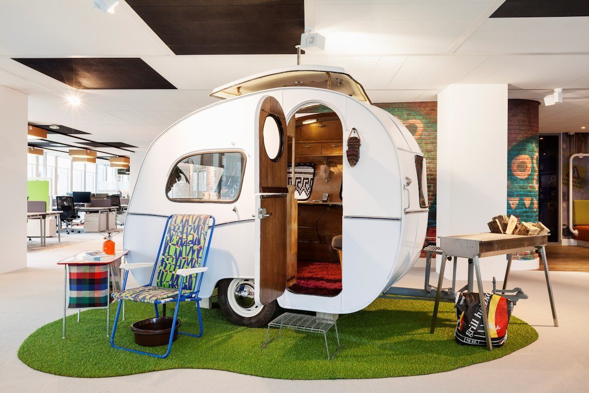 Branding agency insights on best practices for office branding, like this camper in Google's office