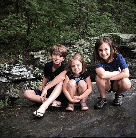 Lance's kids sitting on a rock